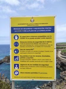 Cartel indicaciones COVID Playa de la Consolación